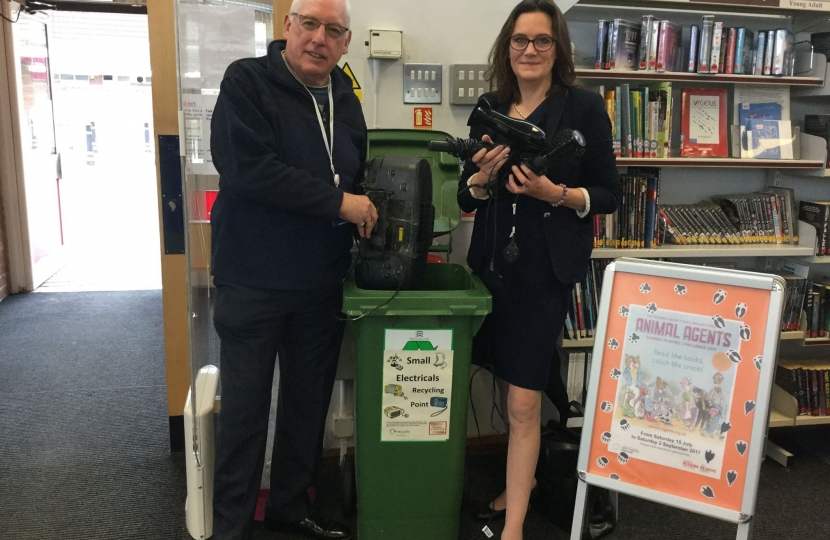 Rebecca Harris and Councillor Chas Mumford encourage recycling