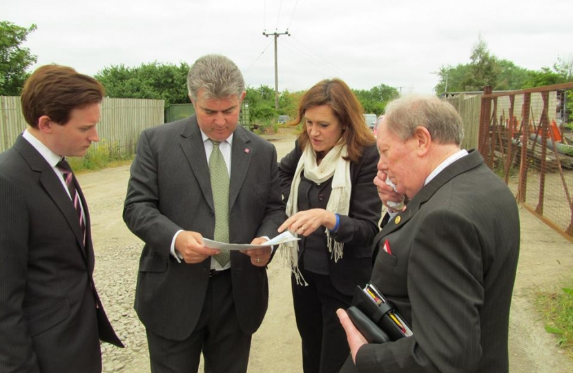 Showing the Minister a possible site for the third road off Canvey